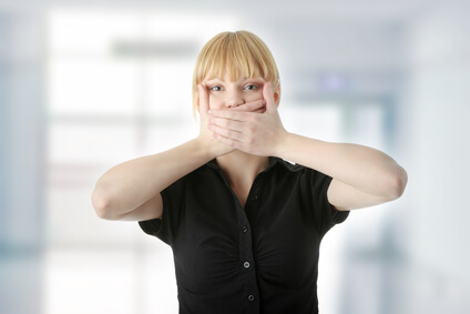Young Woman Covering Her Mouth With Hand, Isolated On White Background