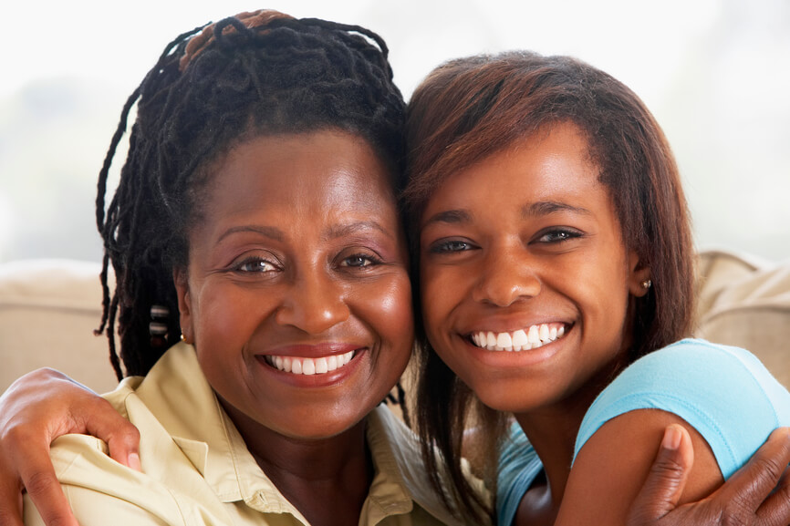 Woman And Teen Daughter, Embracing, Smiling